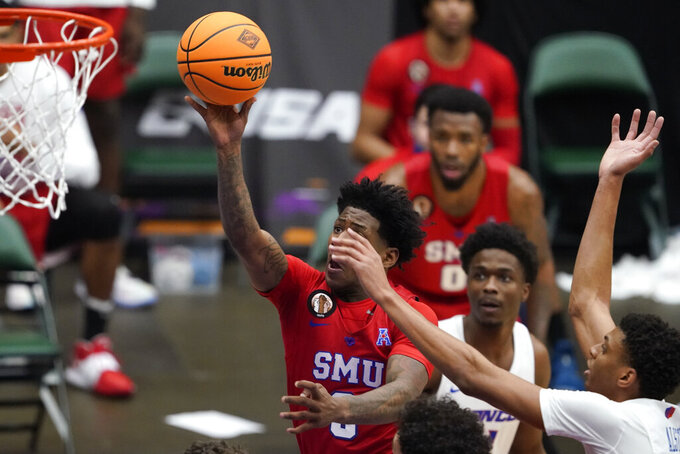 SMU guard Kendric Davis, left, drives to the basket ahead of Boise State guard Derrick Alston Jr., right, during the second half of an NCAA college basketball game in the first round of the NIT, Thursday, March 18, 2021, in Frisco, Texas. (AP Photo/Tony Gutierrez)