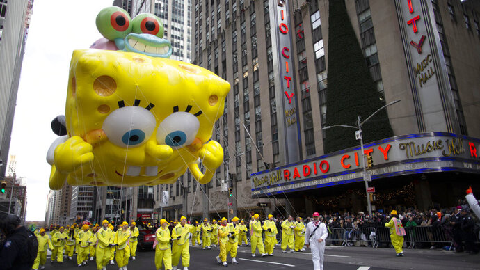 SpongeBob Square Pants & Gary balloon makes its way down Sixth Avenue during the Macy's Thanksgiving Day Parade, Thursday, Nov. 28, 2019, in New York. (AP Photo/Eduardo Munoz Alvarez)