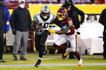 Carolina Panthers wide receiver Curtis Samuel (10) runs with the ball as he is chased by Washington Football Team defensive back Jeremy Reaves (39) during the first half of an NFL football game, Sunday, Dec. 27, 2020, in Landover, Md. (AP Photo/Susan Walsh)