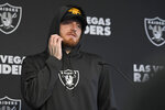 Las Vegas Raiders defensive end Max Crosby speaks during a press conference after NFL football practice Wednesday, Oct. 13, 2021, in Henderson, Nev. (AP Photo/David Becker)