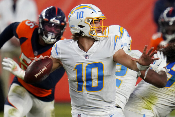 Los Angeles Chargers quarterback Justin Herbert (10) throws against the Denver Broncos during the second half of an NFL football game, Sunday, Nov. 1, 2020, in Denver. (AP Photo/Jack Dempsey)