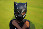 Black Panthers fan, Keyon Griffin, 7, of South Carolina, poses for a portrait during a Chadwick Boseman Tribute on Thursday, Sept. 3, 2020, in Anderson, S.C. (AP Photo/Brynn Anderson)