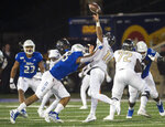 Tulsa defensive end Trevis Gipson, left, hits Central Florida quarterback Dillon Gabriel during an NCAA college football game, Friday, Nov. 8, 2019 in Tulsa, Okla. (Brett Rojo/Tulsa World via AP)