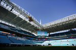 Preparations are underway during a tour of the Hard Rock Stadium on Tuesday, Jan. 21, 2020, ahead of the NFL Super Bowl LIV football game in Miami Gardens, Fla. (AP Photo/Brynn Anderson)