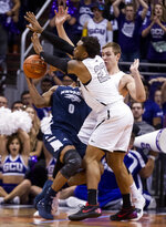 Nevada's Tre'Shawn Thurman (0) is double-teamed by Grand Canyon's Carlos Johnson (23) and Gerald Martin (42) during the first half of an NCAA college basketball game Sunday, Dec. 9, 2018, in Phoenix. (AP Photo/Darryl Webb)