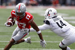 Ohio State receiver Chris Olave, left, cuts upfield against Cincinnati defensive back Cam Jefferies during the first half of an NCAA college football game Saturday, Sept. 7, 2019, in Columbus, Ohio. (AP Photo/Jay LaPrete)