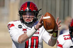 Texas Tech quarterback Alan Bowman (10) tries to hang onto the ball during the first half of an NCAA college football game against Kansas State Saturday, Oct. 3, 2020, in Manhattan, Kan. (AP Photo/Charlie Riedel)