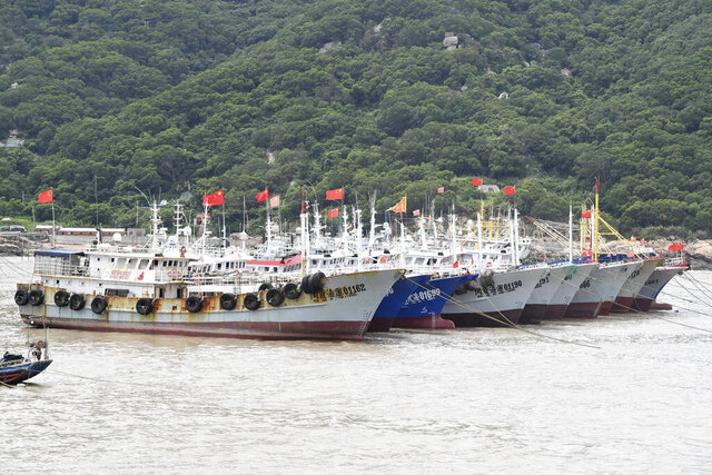 In this photo released by Xinhua News Agency, boats are moored to take shelter from the wind at the coastal area of Sansha Town of Xiapu County in southeastern China's Fujian Province, Monday, Aug. 3, 2020. Typhoon Hagiput brought high winds and heavy rains to China's eastern coastal areas including the financial hub of Shanghai early Tuesday, Aug. 4, 2020. China had ordered evacuations of vulnerable coastal areas in Zhejiang and Fujian provinces to the south, recalled fishing boats and suspended ferry service and some trains. (Lin Shanchuan/Xinhua via AP)