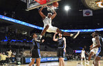Georgia Tech forward Moses Wright (5) hangs from the basket after dunking against Duke during the second half of an NCAA college basketball game Tuesday, March 2, 2021, in Atlanta. (Hyosub Shin/Atlanta Journal-Constitution via AP)