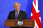 """Britain's Prime Minister Boris Johnson attends a media briefing in Downing Street, London, Monday, June 14, 2021. Johnson has confirmed that the next planned relaxation of coronavirus restrictions in England will be delayed by four weeks until July 19 as a result of the spread of the delta variant. In a press briefing Monday, Johnson said he is """"confident that we won't need more than four weeks"""" as millions more people get fully vaccinated against the virus, which could save thousands of lives. (Jonathan Buckmaster/Pool Photo via AP)"""