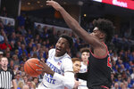Memphis guard Damion Baugh (10) goes up for a basket as Georgia forward Rayshaun Hammonds (20) defends in the second half of an NCAA college basketball game Saturday, Jan. 4, 2020, in Memphis, Tenn. (AP Photo/Karen Pulfer Focht)