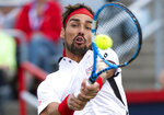 CORRECTS SPELLING TO FOGNINI, INSTEAD OF FOCNINI - Fabio Fognini, of Italy, returns to Rafael Nadal, of Spain, during the Rogers Cup men's tennis tournament Friday, Aug. 9, 2019, in Montreal. (Paul Chiasson/The Canadian Press via AP)