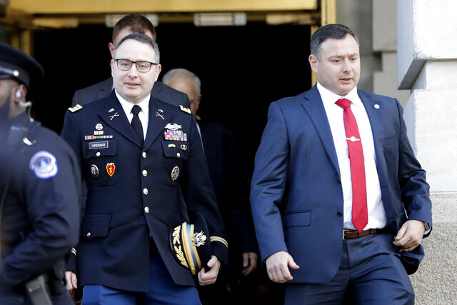 "FILE - In this Nov. 19, 2019, file photo National Security Council aide Lt. Col. Alexander Vindman, left, walks with his twin brother, Army Lt. Col. Yevgeny Vindman, after testifying before the House Intelligence Committee on Capitol Hill in Washington during a public impeachment hearing of President Donald Trump's efforts to tie U.S. aid for Ukraine to investigations of his political opponents. House Democrats are asking a Pentagon watchdog for an investigation into what they say was a ""concerted effort"" by the Trump administration to retaliate against a key impeachment witness, Lt. Col. Alexander Vindman, and his twin brother. (AP Photo/Julio Cortez, File)"