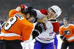 Montreal Canadiens' Jesperi Kotkaniemi, right, and Philadelphia Flyers' Robert Hagg fight during the third period of an NHL hockey game, Thursday, Jan. 16, 2020, in Philadelphia. (AP Photo/Matt Slocum)