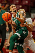 Minnesota forward Jarvis Omersa fouls Green Bay guard Amari Davis (1) during the second half of an NCAA college basketball game Wednesday, Nov. 25, 2020, in Minneapolis. Omersa was called for an intentional foul. (AP Photo/Bruce Kluckhohn)