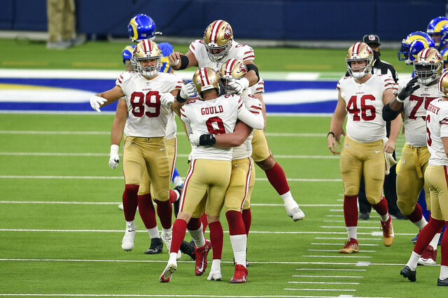 San Francisco 49ers kicker Robbie Gould (9) is hugged by teammates after making the game-winning field goal as time expires during the second half of an NFL football game against the Los Angeles Rams Sunday, Nov. 29, 2020, in Inglewood, Calif. San Francisco won 23-20. (AP Photo/Kelvin Kuo)