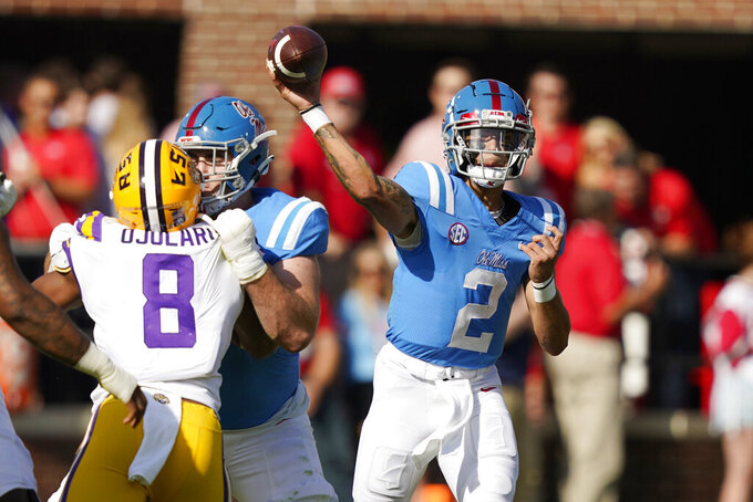 Mississippi quarterback Matt Corral (2) throws a pass against LSU in the first half of an NCAA college football game in Oxford, Miss., Saturday, Oct. 23, 2021. Mississippi won 31-17. (AP Photo/Rogelio V. Solis)
