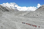 In this May 16, 2020 aerial photo released by Xinhua News Agency, Chinese surveyors hike toward a higher spot from the base camp on Mount Qomolangma at an altitude of 5,200 meters. The Chinese government-backed team plans to summit Mount Everest this week at a time when the world's tallest peak has been closed to commercial climbers. (Jigme Dorje/Xinhua via AP)