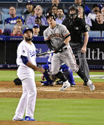 San Francisco Giants' Tyler Austin, center, watches his home run off Los Angeles Dodgers relief pitcher Yimi Garcia, front, during the fourth inning of a baseball game Wednesday, June 19, 2019, in Los Angeles. (AP Photo/Mark J. Terrill)