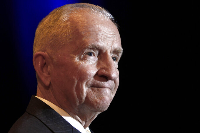 FILE - In this April 20, 2019, file photo, Ross Perot listens to a reporter's question during a news conference before accepting the Command and General Staff College Foundation's 2010 Distinguished Leadership Award in Kansas City, Mo. Wealth, fame and a confident prescription for the nation's economic ills propelled H. Ross Perot's 1992 campaign against President George H.W. Bush and Democratic challenger Bill Clinton. He recorded the highest percentage for an independent or third-party candidate since 1912. He died in July. (AP Photo/Ed Zurga, File)