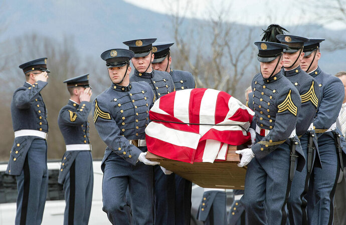In this Friday, Feb. 15, 2019 photo, VMI cadets carry the flag-draped coffin of former Secretary of the Army John Marsh Jr. outside New Market Battlefield State Historical Park during his funeral in New Market, Va. Marsh, who also served four terms as Virginia's 7th District congressman, died at age 92 on Feb. 4 at Blue Ridge Christian Home in Raphine.  (Rich Cooley/Northern Virginia Daily via AP)