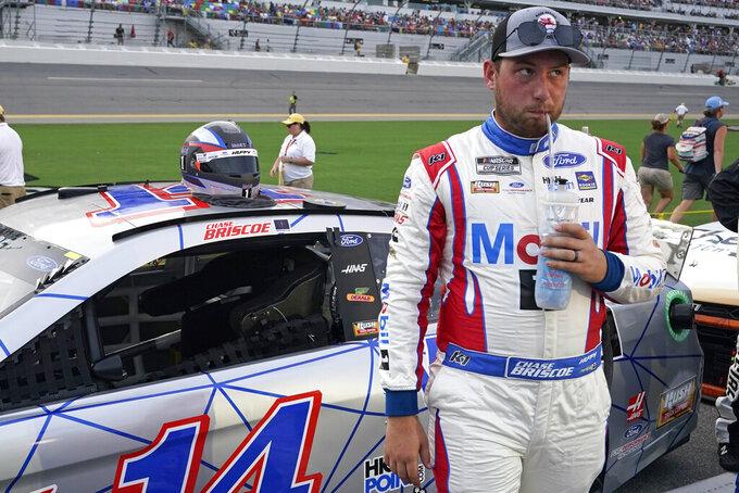 Chase Briscoe hydrates before the NASCAR Cup Series auto race at Daytona International Speedway, Saturday, Aug. 28, 2021, in Daytona Beach, Fla. (AP Photo/John Raoux)