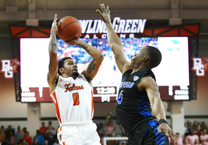 Bowling Green guard Michael Laster (0) shoots over Buffalo guard Davonta Jordan (4) in the second half of an NCAA college basketball game in Bowling Green, Ohio, Friday, Feb. 1, 2019. (AP Photo/Rick Osentoski)