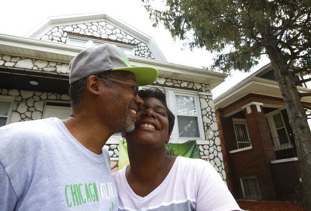 Hasan and Mary Smith stand cheek to cheek outside their newly rehabbed home in the Chicago Lawn neighborhood of Chicago on Sept. 11, 2019. The home is one of dozens of