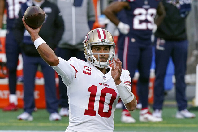 San Francisco 49ers quarterback Jimmy Garoppolo passes against the New England Patriots in the first half of an NFL football game, Sunday, Oct. 25, 2020, in Foxborough, Mass. (AP Photo/Steven Senne)