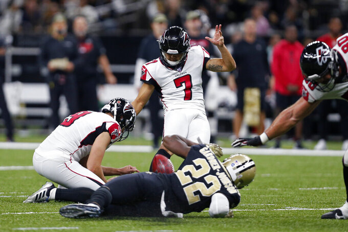 Atlanta Falcons kicker Younghoe Koo kicks a field goal as New Orleans Saints defensive back Chauncey Gardner-Johnson (22) tries to block in the first half of an NFL football game in New Orleans, Sunday, Nov. 10, 2019. (AP Photo/Butch Dill)
