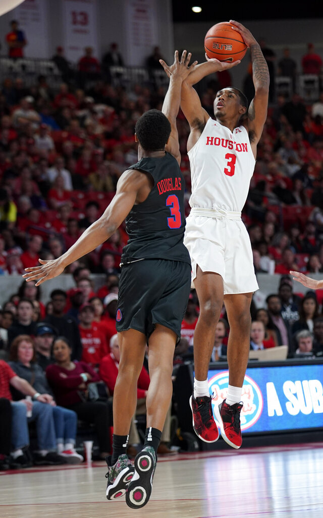 Houston's Armoni Brooks, right, shoots as Southern Methodist's William Douglas defends during the first half of an NCAA college basketball game Thursday, March 7, 2019, in Houston. (AP Photo/David J. Phillip)