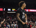 Central Florida guard Brandon Mahan (13) during the second overtime of the team's NCAA college basketball game against Cincinnati on Wednesday, Feb. 19, 2020, in Cincinnati. (Albert Cesare/The Cincinnati Enquirer via AP)