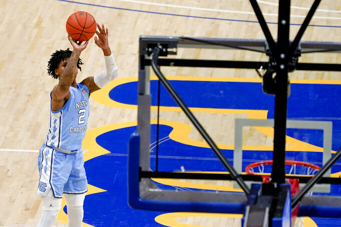 North Carolina's Caleb Love hits a 3-pointer against Pittsburgh during the second half of an NCAA college basketball game Tuesday, Jan. 26, 2021, in Pittsburgh. (AP Photo/Keith Srakocic)