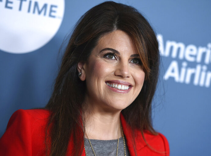 "FILE - In this Wednesday, Dec. 5, 2018, file photo, Monica Lewinsky arrives at The Hollywood Reporter's Women in Entertainment Breakfast at Milk Studios in Los Angeles. FX says the next chapter of its ""American Crime Story"" series will dramatize the impeachment of President Bill Clinton. The miniseries will air in September 2020, within weeks of the general election. Lewinsky, the central figure in Clinton's impeachment, is a producer for the limited series. (Photo by Jordan Strauss/Invision/AP, File)"