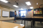 In thi Friday, May 15, 2020 photo, third grade teacher Liz Magnuson takes one last look at her empty classroom at Rosa Parks Elementary in Sioux Falls, S.D., before leaving it for the summer (Erin Bormett/The Argus Leader via AP)