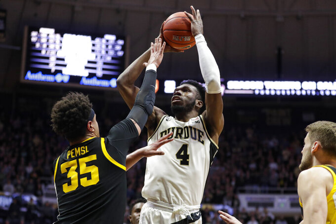 Purdue center Emmanuel Dowuona (4) shoots over Iowa forward Cordell Pemsl (35) during the second half of an NCAA college basketball game in West Lafayette, Ind., Wednesday, Feb. 5, 2020. Purdue defeated Iowa 104-68. (AP Photo/Michael Conroy)