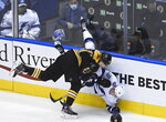 Boston Bruins left wing Nick Ritchie (21) takes out Tampa Bay Lightning left wing Ondrej Palat (18) during the first period of an NHL hockey playoff game  Wednesday, Aug. 5, 2020 in Toronto. (Nathan Denette/The Canadian Press via AP)