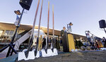 Gov. Jay Inslee speaks as engraved shovels stand at the ready before a ceremonial groundbreaking of a renovation of the arena behind at Seattle Center Wednesday, Dec. 5, 2018, in Seattle. The NHL Board of Governors gave final approval to Seattle's bid to add the hockey league's 32nd team a day earlier and play is expected to begin at the arena in 2021. (AP Photo/Elaine Thompson)