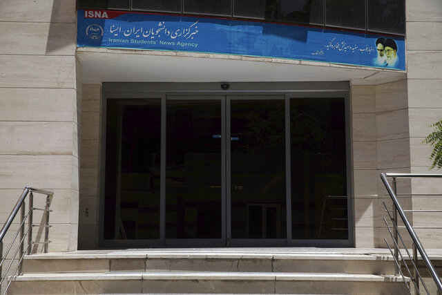 The gate of the Iran's semiofficial ISNA news agency is seen in Tehran, Iran, Friday, June 5, 2020. The head of Iran's semiofficial ISNA news agency has been convicted over publishing an article that quotes a former ambassador criticizing Tehran's