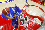 Amedeo Tessitori of Italy goes for a shot over Ramon Clemente and Gian Clavell of Puerto Rico during their Group J second phase match for the FIBA Basketball World Cup, at the Wuhan Sports Center in Wuhan in central China's Hubei province, Sunday, Sept. 8, 2019. (AP Photo/Andy Wong, Pool)