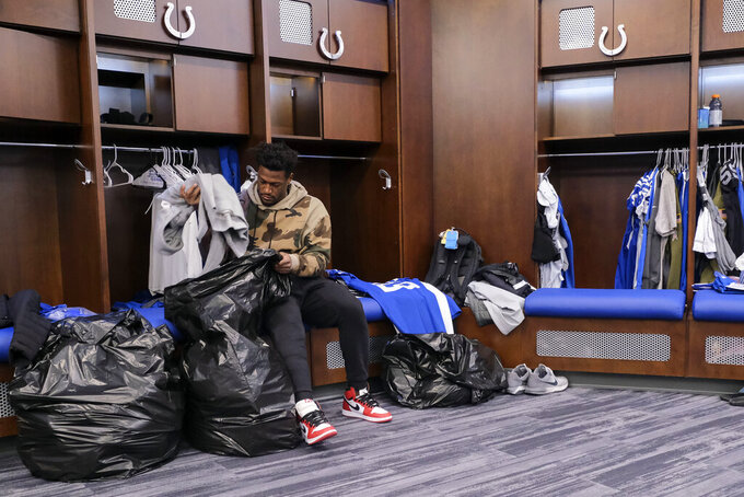 Indianapolis Colts running back Marlon Mack cleans out his locker at the NFL team's facility in Indianapolis, Sunday, Jan. 13, 2019. The team ended their season with a loss to Kansas City in a playoff game the day before. (AP Photo/AJ Mast)