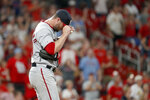 Washington Nationals relief pitcher Hunter Strickland adjusts his cap after giving up a ground-rule double to St. Louis Cardinals' Marcell Ozuna, scoring two runs, during the seventh inning of a baseball game Monday, Sept. 16, 2019, in St. Louis. (AP Photo/Jeff Roberson)