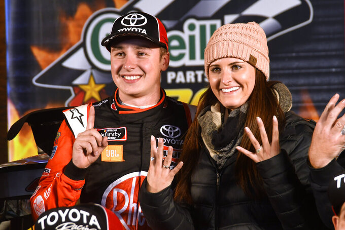 Christopher Bell and his fiancé Morgan Kemenah celebrate in Victory Lane after Bell won a NASCAR Xfinity auto race at Texas Motor Speedway in Fort Worth, Texas, Saturday, Nov. 2, 2019. (AP Photo/Randy Holt)