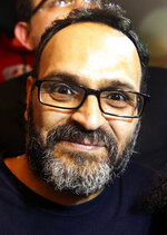 Ziad Itani, a Lebanese stage actor, who was indicted on charges of collaborating with Israel and drug possession, smiles after he was released by Lebanese authorities, in Beirut, Lebanon, Tuesday, March 13, 2018. Itani was released on Tuesday and cleared of charges, while the officer who built the case against him was ordered detained.(AP Photo/Hussein Malla)