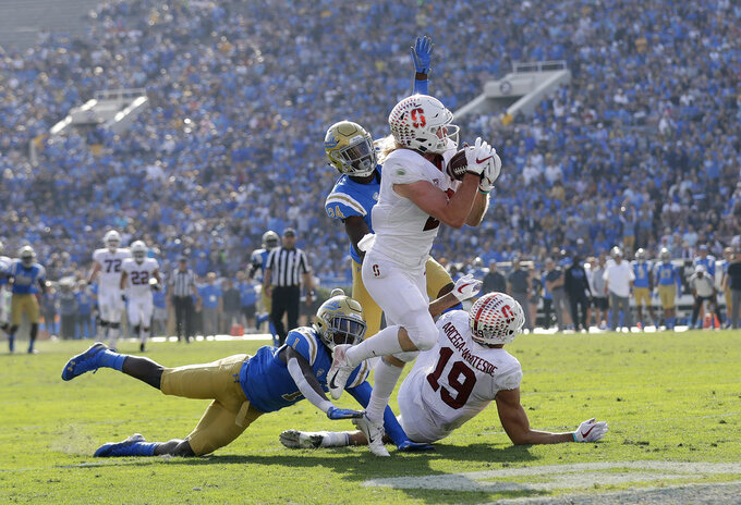 Stanford wide receiver Trenton Irwin, center, catches a pass for a touchdown against UCLA during the first half of an NCAA college football game Saturday, Nov. 24, 2018, in Pasadena, Calif. (AP Photo/Marcio Jose Sanchez)