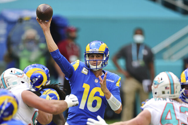 Los Angeles Rams quarterback Jared Goff (16) throws the ball over the Miami Dolphin defenders in an NFL game, Sunday, Nov. 1, 2020 in Miami Gardens, Fla. The Dolphins defeated the Rams 28-17. (Margaret Bowles via AP)