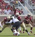 Florida State's quarterback Deondre Francois manages to control a high snap in the second quarter of an NCAA college football game against Wake Forest, Saturday, Oct. 20, 2018 in Tallahassee, Fla. Florida State won 38-17. (AP Photo/Steve Cannon)