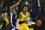 Baylor forward Freddie Gillespie (33) holds off Kansas State forward Antonio Gordon (11) in the first half of an NCAA college basketball game, Tuesday, Feb. 25, 2020, in Waco, Texas. (AP Photo/ Jerry Larson)