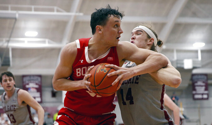 Boston University's  Max Mahoney, left, drives past Colgate's Keegan Records, right during first half of the NCAA Patriot League Conference basketball tournament championship game at Cotterell Court, Wednesday, March 11, 2020, in Hamilton, N.Y. (AP Photo/John Munson)