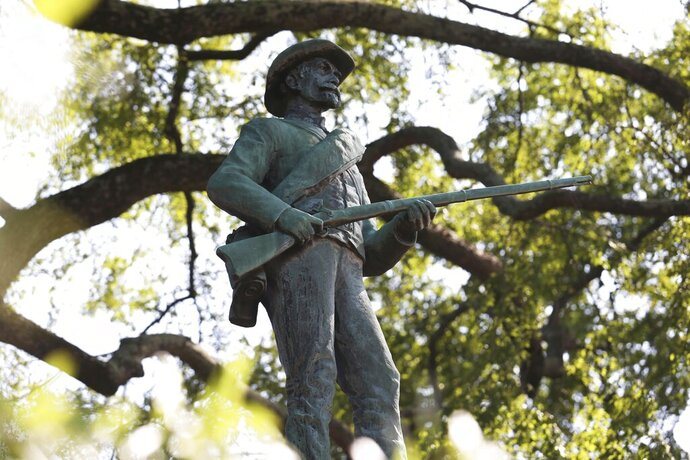 FILE - This Sept. 2, 2020 file photo shows a bronze statue of an unnamed Confederate soldier, titled